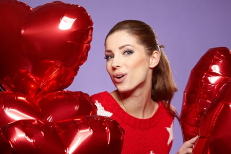 woman with red heart balloon photo