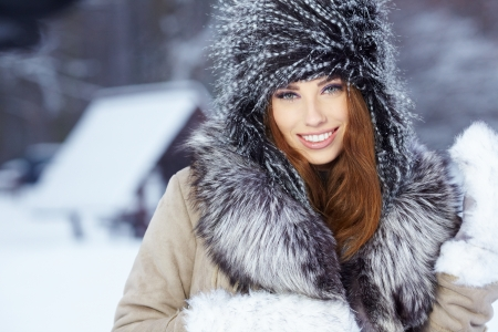 portrait of a young woman in winter park  photo