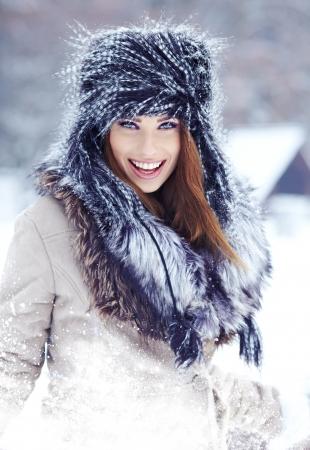 fur tree: beautiful girl in the park in winter
