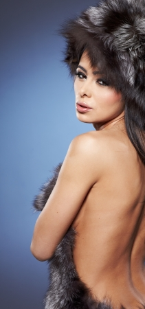 portrait of stylish woman in fur against blue background Stock Photo - 17384143