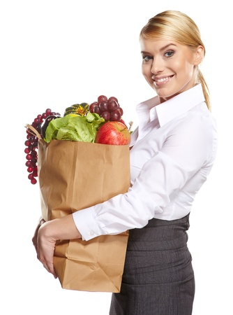 Portrait of happy business woman holding a shopping bag full of groceries on white background  Stock Photo - 17417766
