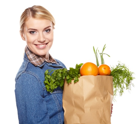 Young woman with a grocery shopping bag  Isolated on white background   Stock Photo - 17417767