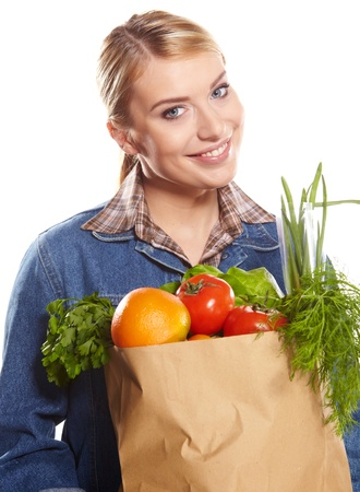 Young woman with a grocery shopping bag  Isolated on white background   Stock Photo - 17417761