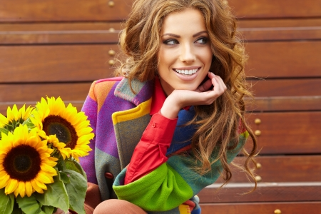 Fashion woman with sunflower at outdoor   Stock Photo - 17501675