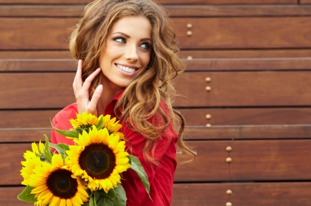 Fashion woman with sunflower at outdoor Stock Photo - 17501670