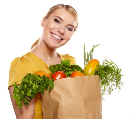 Young woman with a grocery shopping bag  Isolated on white background   photo