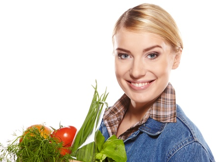 Woman with a shopping bag filled with nutritious fruit and vegetables  Stock Photo - 17446175