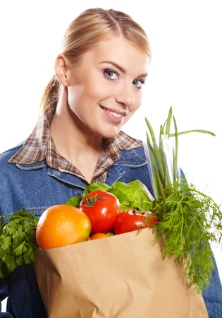Young woman with a grocery shopping bag  Isolated on white background   Stock Photo - 17446199