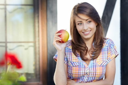green apples: Apple woman. Very beautiful  model eating red apple in the park.