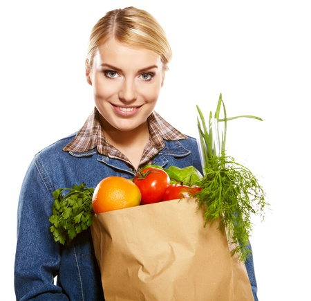 vegs: woman holding a bag full of healthy food  shopping