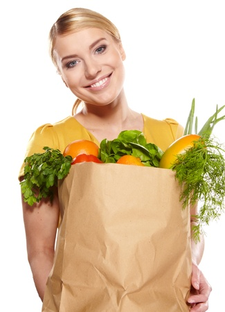 Portrait of happy young woman holding a shopping bag full of groceries on white background Stock Photo - 17564553