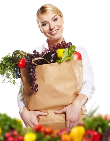 Young woman with a grocery shopping bag. Isolated on white background. Stock Photo - 17701771