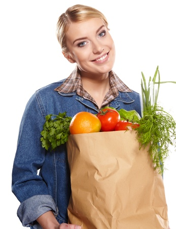 Young woman with a grocery shopping bag. Isolated on white background.  Stock Photo - 17646945