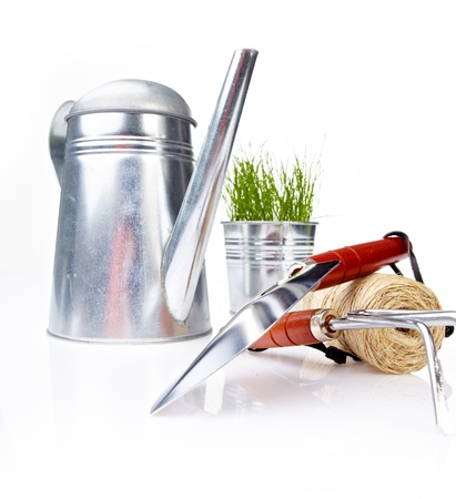 garden tool: Garden tools and watering can with grass on white  Stock Photo