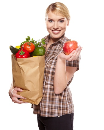 woman holding a bag full of healthy food. shopping . Stock Photo - 17751343