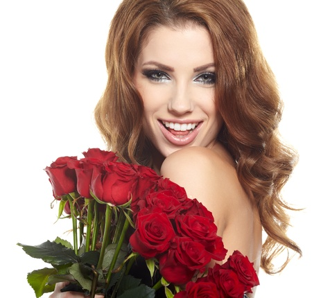 Beautiful female holding red roses bouquet, valentines day   photo