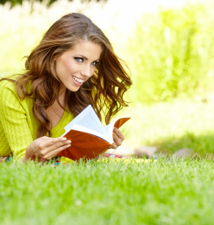 spring fashion: beautiful girl with book in the spring park