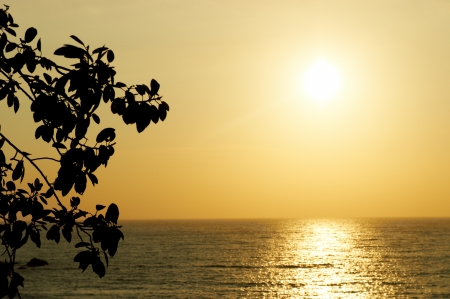 evening glow:  waves and sunset in Goa in India  Stock Photo