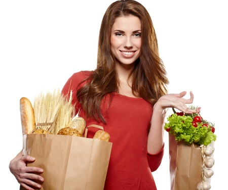 Smiling woman holding a grocery bag  photo