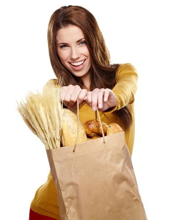 Young woman holding a grocery bag full of bread Stock Photo - 17917934