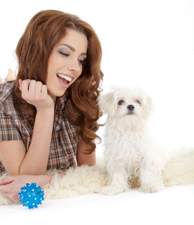 Playing with her dog Stock Photo - 18000243