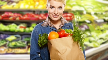 beautiful young woman with vegetables and fruits in shopping bag  photo