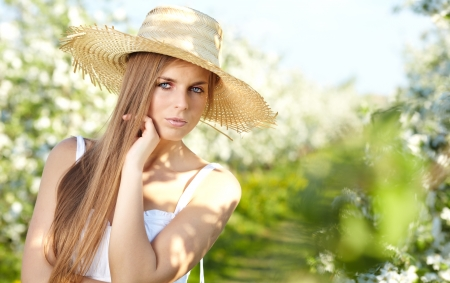 beautiful blonde in a spring garden  photo