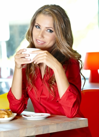 Beautiful young college student on a cafe   Stock Photo - 18213188