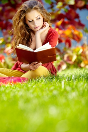 beautiful girl with book in the spring  park  photo