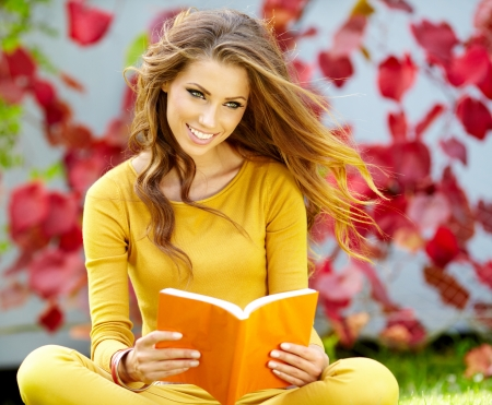 beautiful girl with book in the spring  park  Stock Photo