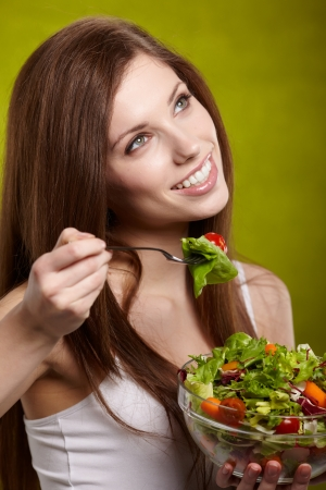 happy healthy woman with salad  photo