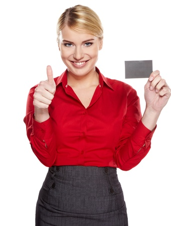 Businesswoman holding credit card  Isolated on white photo
