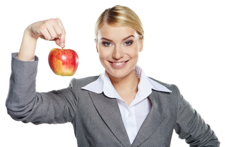 Businesswoman with red apple in her hand - healthy eating concept  photo
