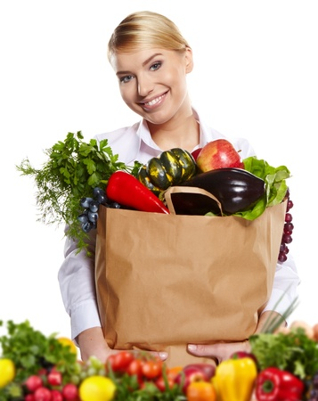 Young woman with a grocery shopping bag  Isolated on white background   Stock Photo - 18285473