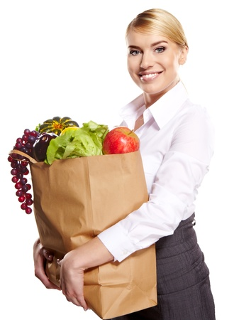 Young woman with a grocery shopping bag  Isolated on white background Stock Photo - 18285470