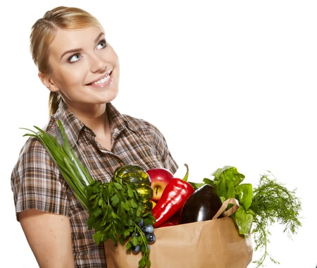 Young woman with a grocery shopping bag  Isolated on white background Stock Photo - 18285481