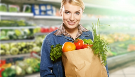 Woman grocery shopping at the local market  Stock Photo - 18354997