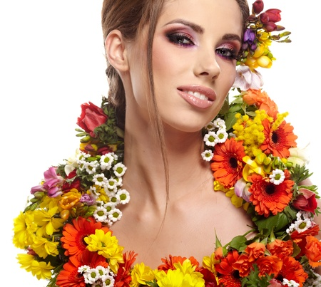 gracefully: portrait of a woman dressed in spring flowers Stock Photo