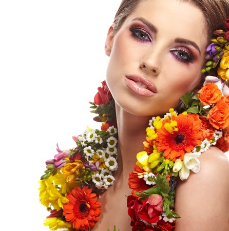 red head girl: portrait of a woman dressed in spring flowers Stock Photo
