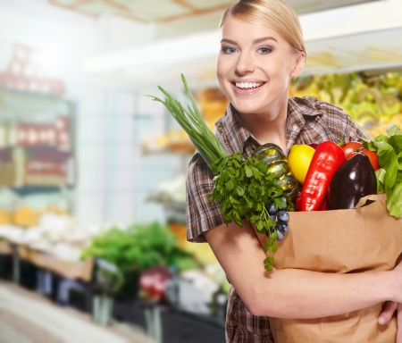 woman shopping for fruits and vegetables in produce department of a grocery store/supermarket Stock Photo - 18548100