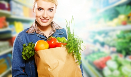 hypermarket: Beautiful young woman shopping for diary products at a grocery storesupermarket Stock Photo