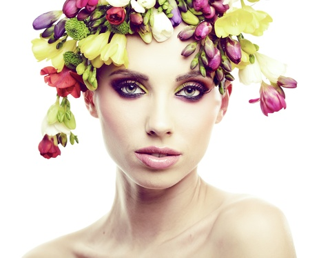 Beautiful young woman with flower  photo
