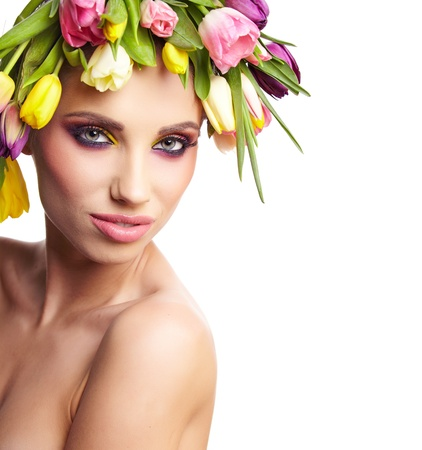 fashion model with large hairstyle and flowers in her hair   photo