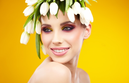 Beautiful woman with flower wreath   photo