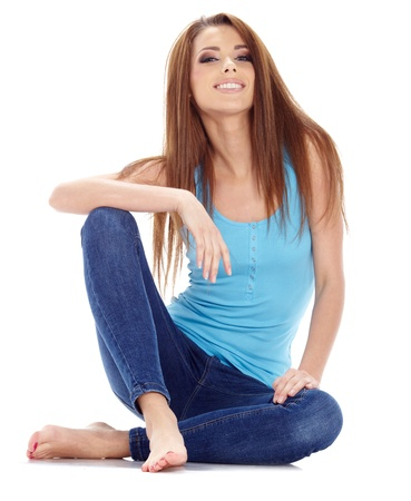 woman sitting floor: Sexy girl in blue jeans