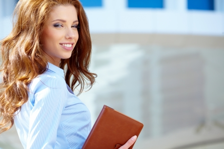 Beautiful business woman on the background of the modern office  photo