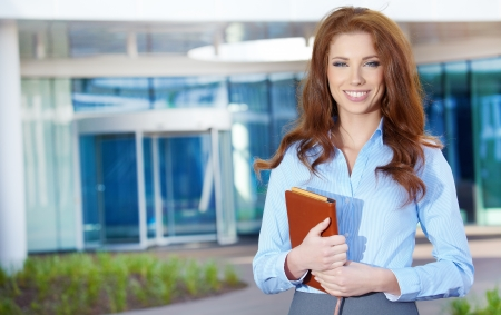 career women: Young happy women or student on the property business background