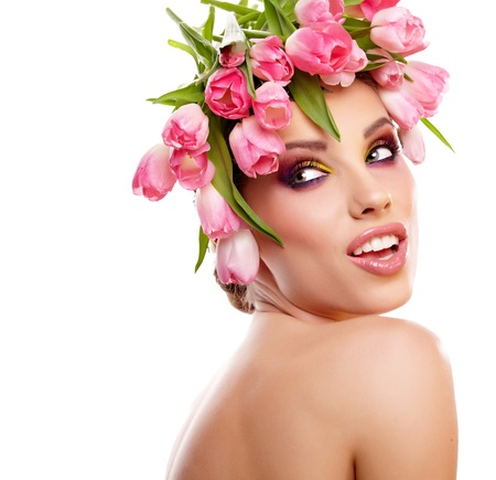 beauty woman portrait with wreath from flowers on head over white background  photo
