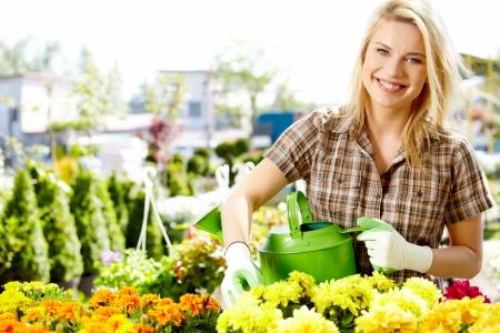 Female florist or gardener in flower shop or nursery  photo