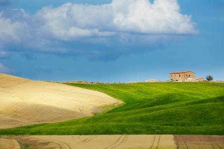Tuscany landscape with typical farm house on a hill in Val dOrcia, Italy  photo